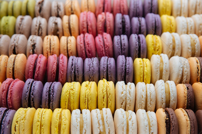 Rows of colorful macaroon cookies