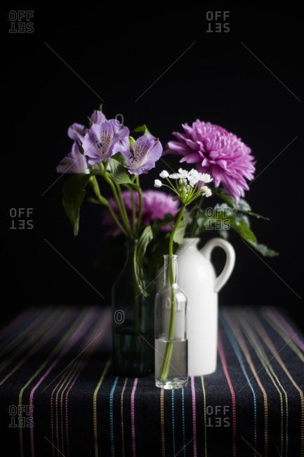 Purple flowers in bottles