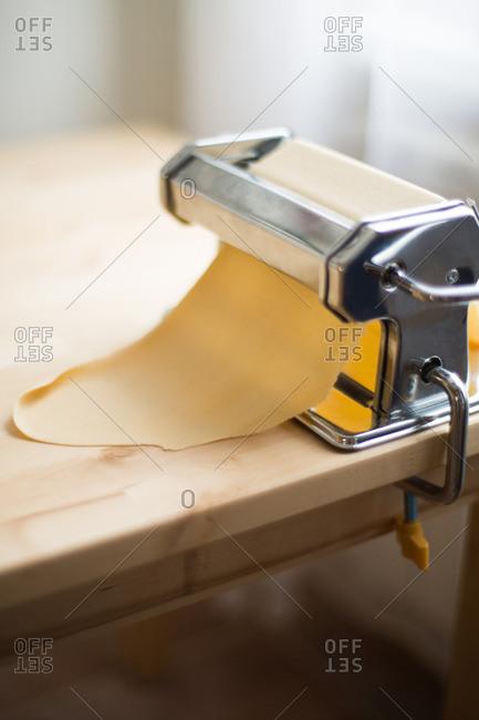 Pasta dough in rolling machine