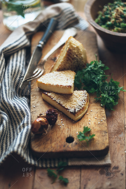 Baked cheese with leafy greens