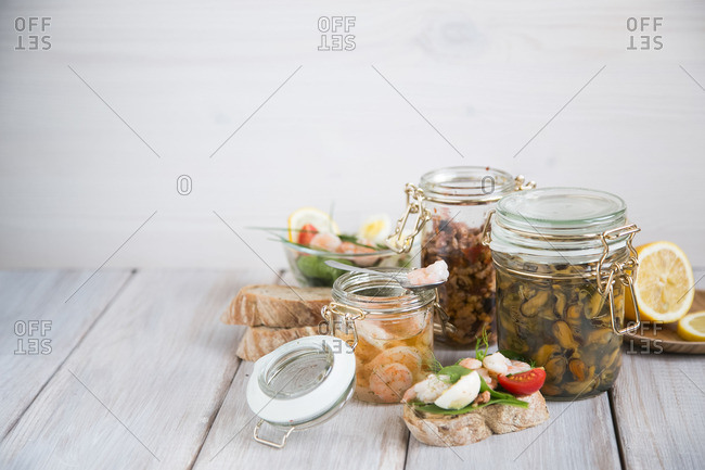 Sandwich by jars of seafood