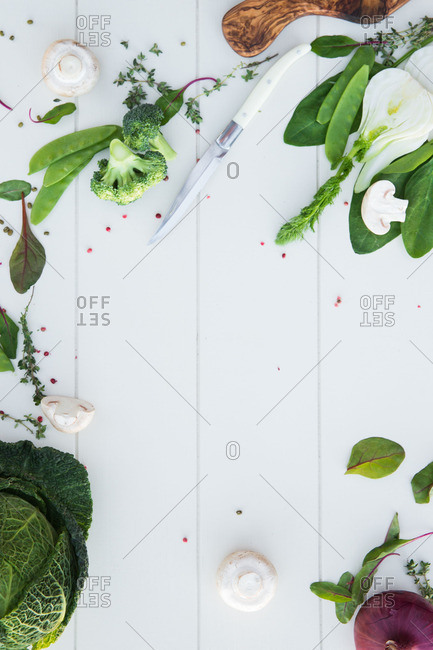 Raw veggies on a white background