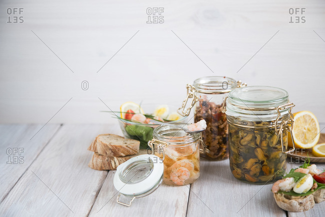 Jars of seafood and sandwiches