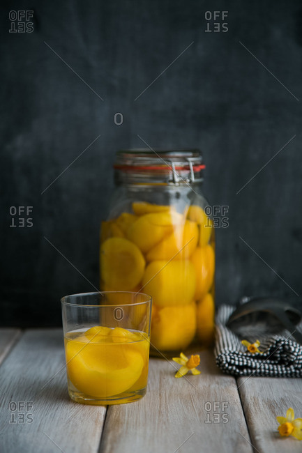 Peaches in glass and jar