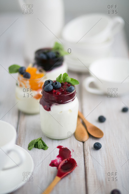Jars with fruit and yogurt
