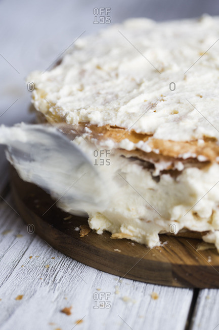 Spoon spreading cream on mille feuille cake