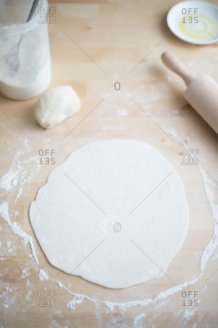 Rolled out raw pizza dough