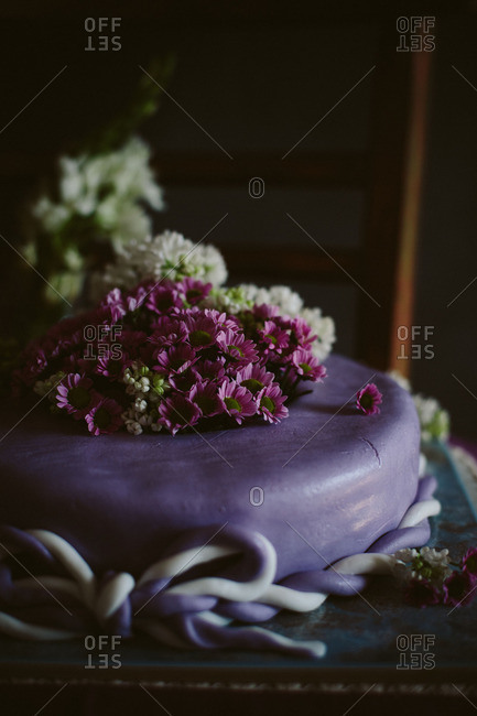Purple cake topped with flowers