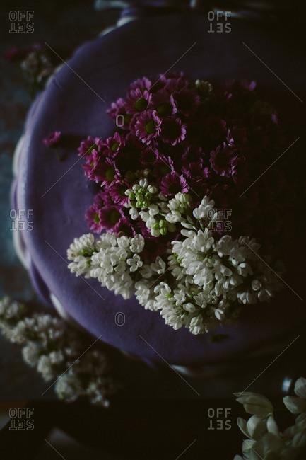 Flowers on a purple cake