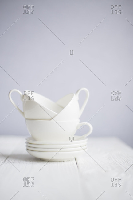 Cups stacked on saucers