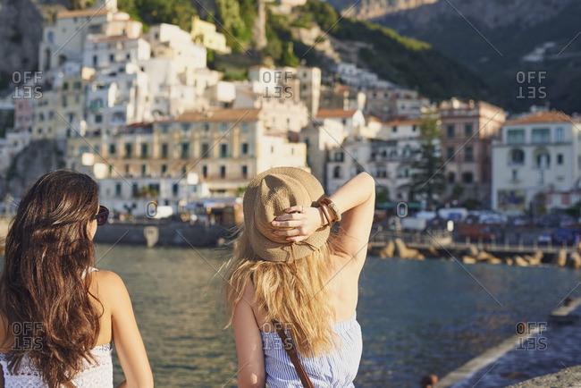 Beautiful girl friends enjoying scenic view of Amalfi Coast