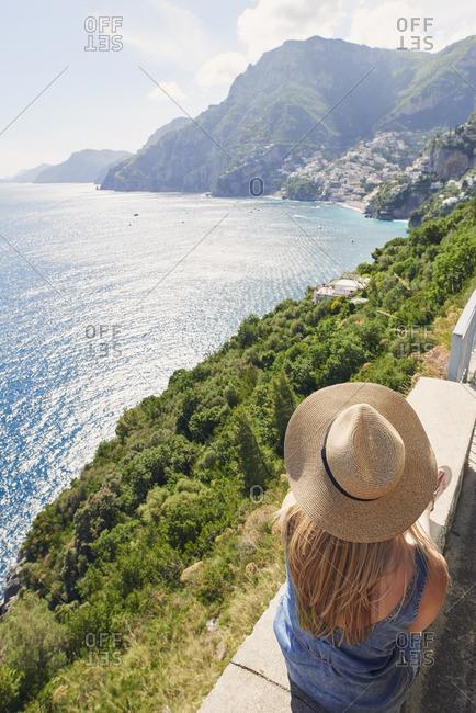 Beautiful girl enjoying scenic view of Amalfi Coast