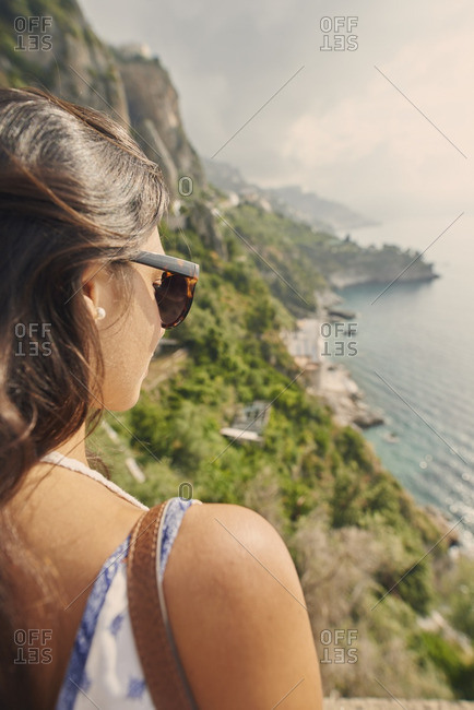 Beautiful girl enjoying scenic view of Amalfi Coast