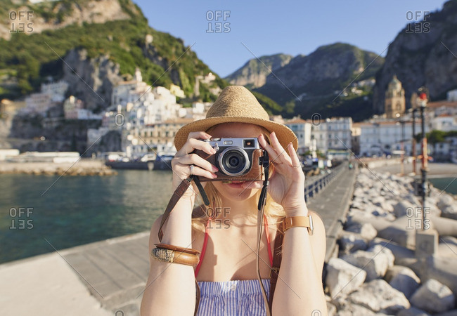 Woman taking photos with vintage camera