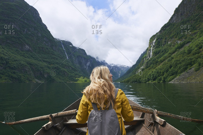 Woman enjoying majestic river view from row boat