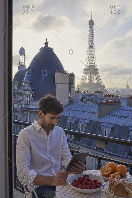 Man using digital tablet technology