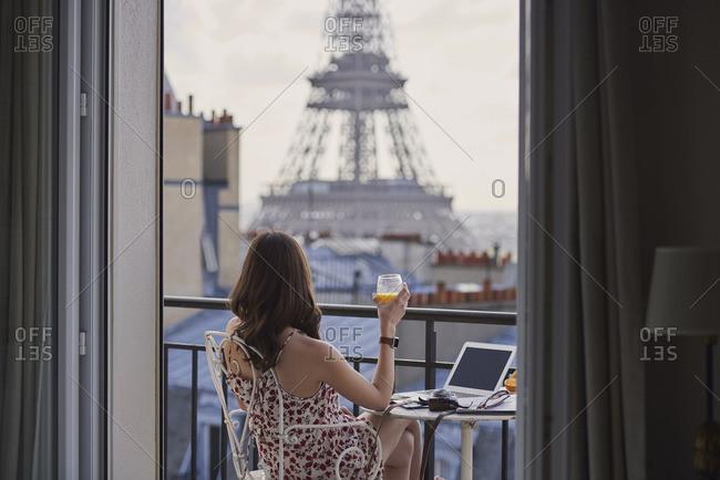 Woman enjoying view of Eiffel Tower
