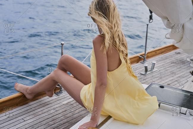 Beautiful woman on sailboat in ocean