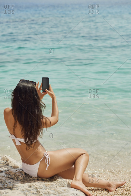 Beautiful woman taking photos with smart phone