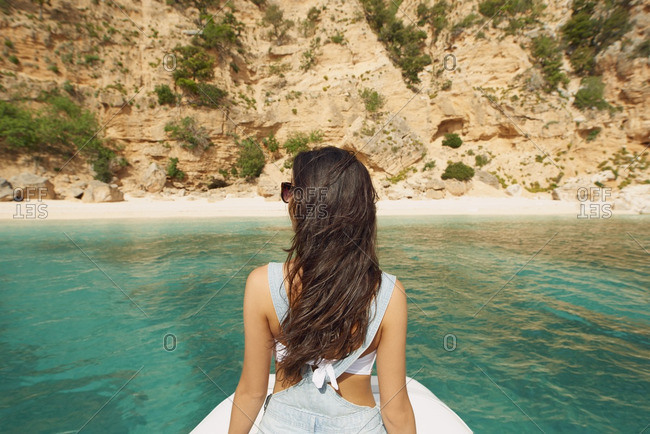 Beautiful woman on speed boat