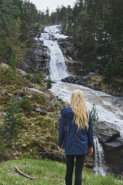 Woman exploring Beautiful waterfall