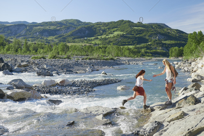 Brave girl friends cross river on adventure