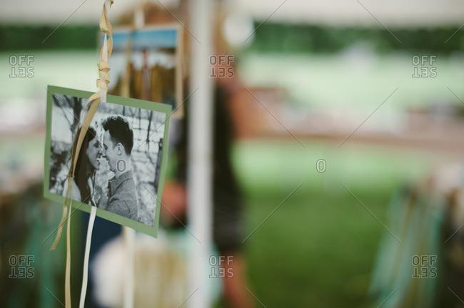 Hanging photos at a bridal shower