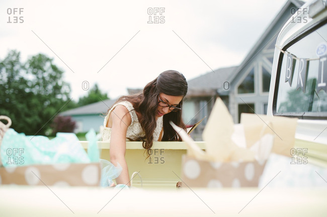 Woman reaching into the back of a pickup truck at her bridal shower