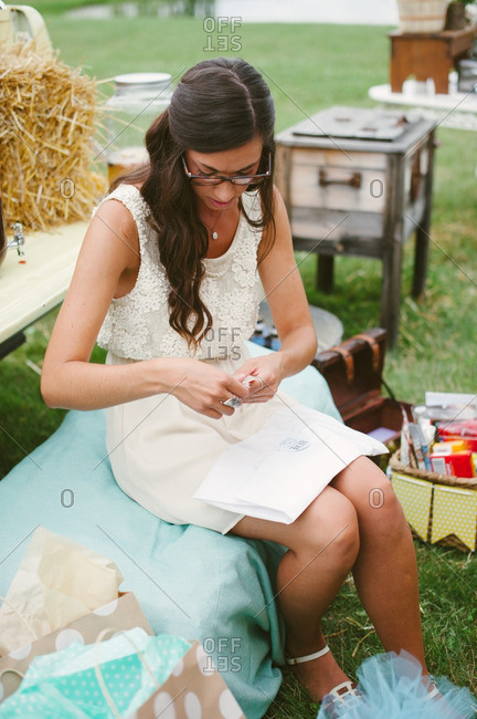 Young bride opening gifts at her bridal shower