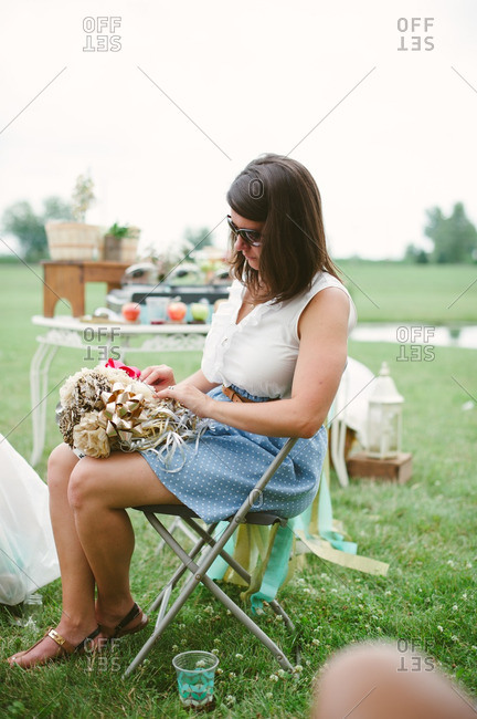 Woman holding ribbon bouquet at a bridal shower