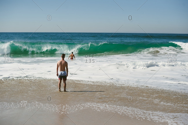 Two men swimming in the Pacific ocean