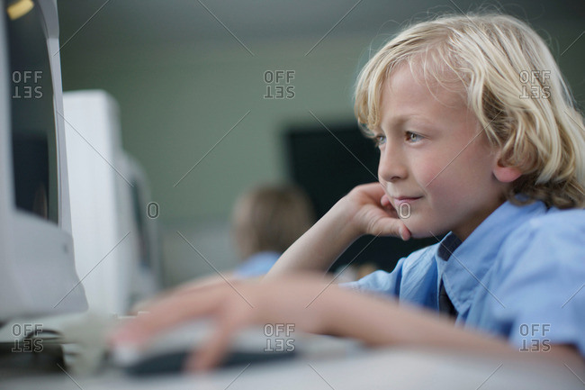 School boy using computer