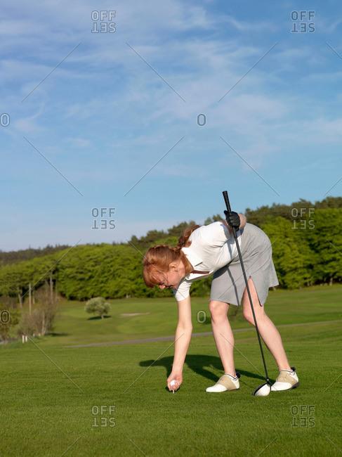 Woman at golf tee