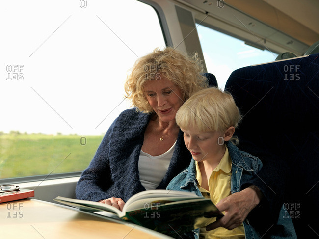 Grandmother and grandson on train