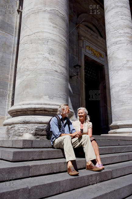 Couple resting on stairs