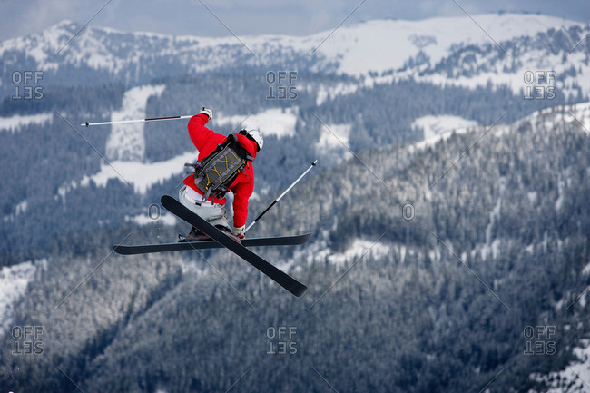 Skier jumping trees in the background