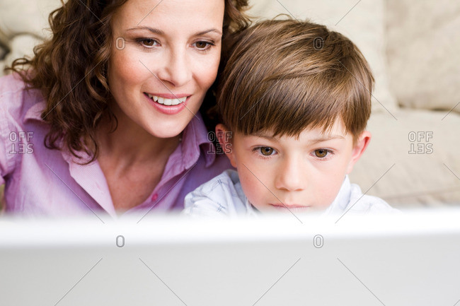 Woman and son staring at laptop