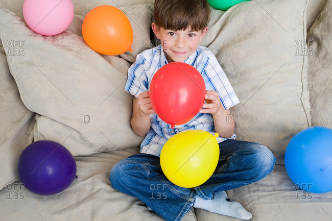Young boy with lot of balloons