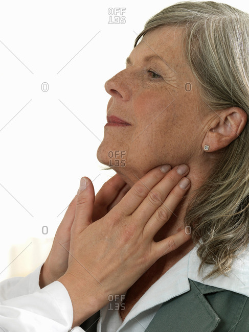 Doctor examining mature woman