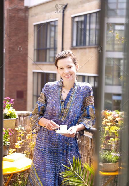 Woman on balcony with espresso