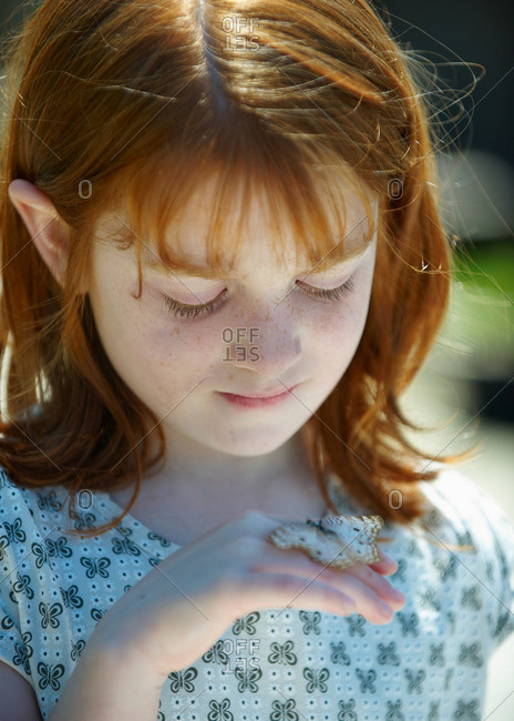 Young girl looking at butterfly