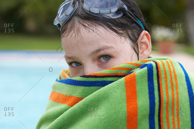 Young girl wrapped in a towel