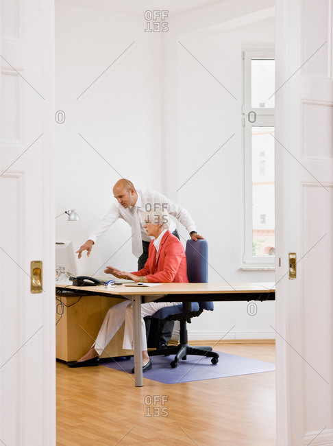 Woman and man working on computer