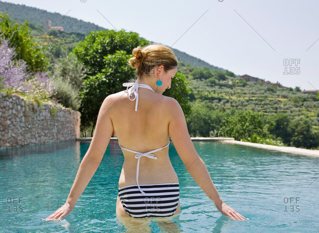 Woman wading in the pool