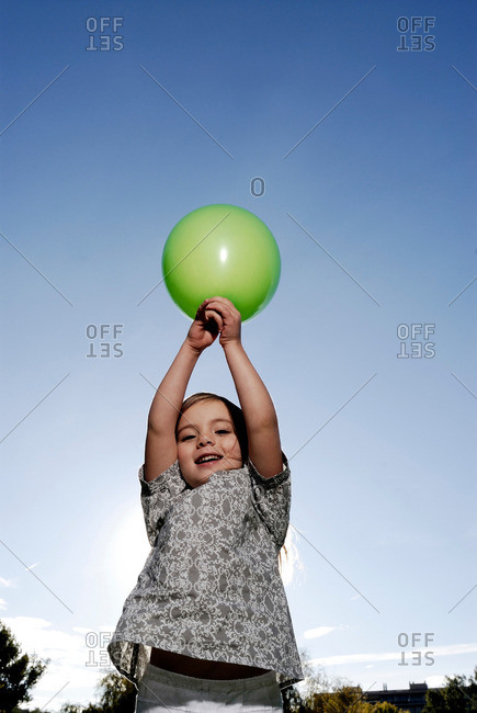 5 years old girl holding a balloon