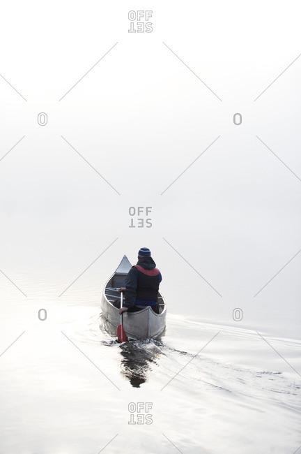 Kayaking in the morning mist.
