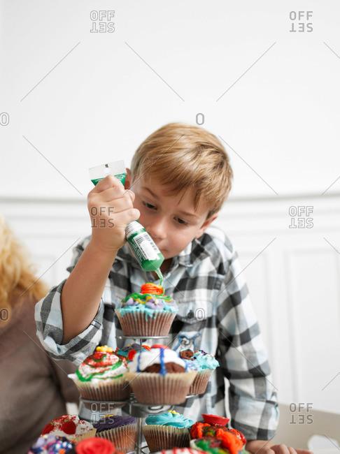 Boy making Cupcakes