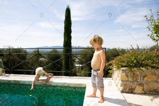 2 boys at pool