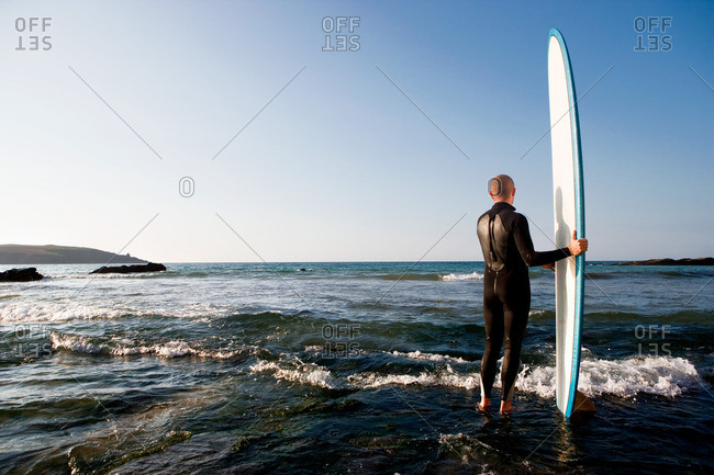 Man standing in shallow water