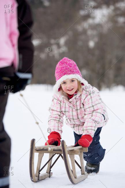Young girl towed on sledge